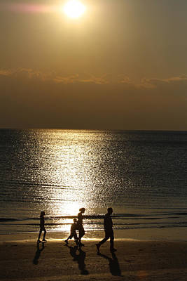 Photograph - Family Sunset Jog by Dart and Suze Humeston