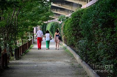 Photograph - Family Walks Down Tree And Hedge Lined Footpath by Imran Ahmed