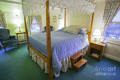 Photograph - Fancy Canopy Bed In A Cozy Hotel Bedroom. by Don Landwehrle