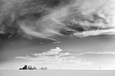 Farm In The Distance In A Snowy Field Art Print by Patrick LaRoque