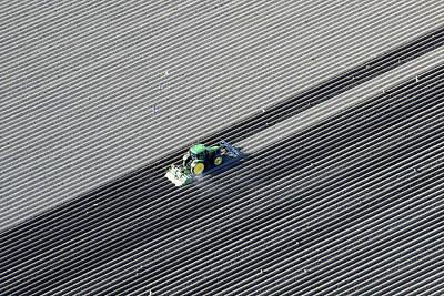 Flevoland Photograph - Farmer Plowing Potato Field, Lelystad by Bram van de Biezen