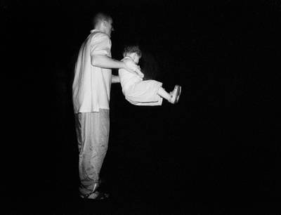 Nyc Photograph - Father And Son In Dark by Dave Beckerman