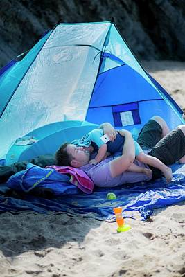 Father Holding Son In A Tent On Beach Art Print by Samuel Ashfield