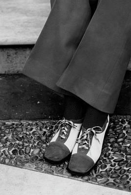 Feet Of A Model Wearing Two-tone Pant Shoes Art Print