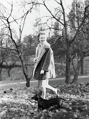 Winter Trees Photograph - Felicia Montealegre Wearing A Dior Coat by Henry Clarke