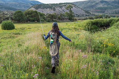 Colorado Fly Fishing River Wall Art - Photograph - Female Angler Walking Through Meadow by Jennifer Magnuson