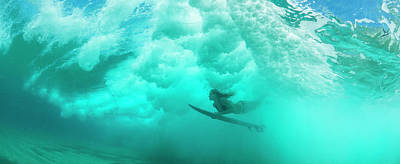 Female Surfer Pushes Under A Wave While Art Print