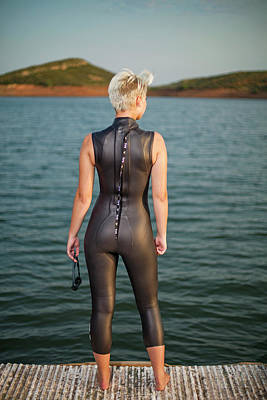 Female Triathlete In A Wetsuit Standing Art Print