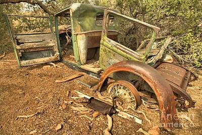Mining Truck Photograph - Fenders Doors And Corrosion by Adam Jewell