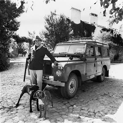 Male Dog Photograph - Fernando Fernandez Holding A Winchester Gun by Leonard Nones