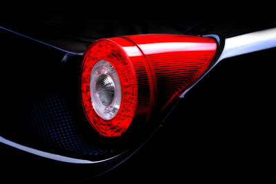 Photograph - Ferrari 458 Italia Tail Light by Mark Rogan