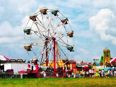Amusement Parks Photograph - Ferris Wheel Against Blue Sky by Susan Savad