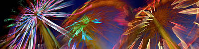Enjoyment Photograph - Ferris Wheel Spinning At Night by Panoramic Images