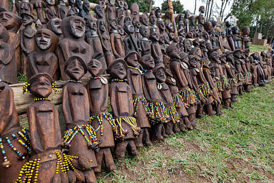 Carving Photograph - Figure Carvings At The Market by Tom Norring