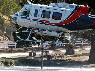 Photograph - Fire Helicopter Loading Water From Pond by Jeff Lowe