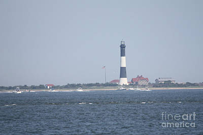 Photograph - Fire Island Lighthouse With Signal Light Showing And Boats Wading #4 Of 4 by John Telfer
