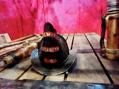Photograph - Fireman - Fire Helmet In Fire Truck by Susan Savad