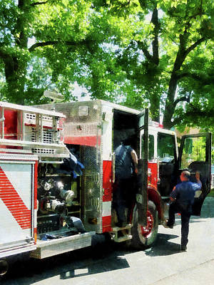 Photograph - Fireman - Getting Into The Fire Truck by Susan Savad