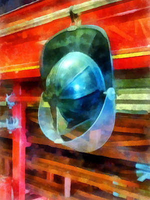 Photograph - Fireman - Helmet Hanging On Fire Truck by Susan Savad