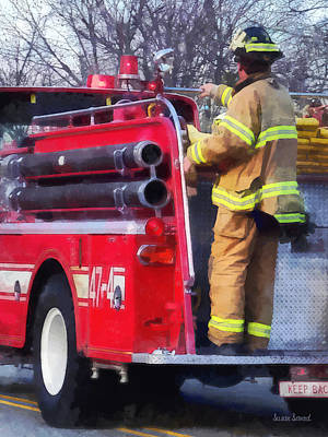 Fireman On Back Of Fire Truck Art Print by Susan Savad