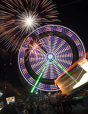 Fireworks Bursting Over A Ferris Wheel Carnival Ride Art Print