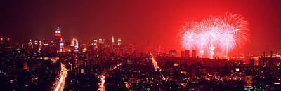 Fireworks Display At Night Over A City Art Print