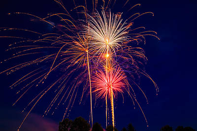 Aromatherapy Oils Royalty Free Images - Fireworks over the Pines Royalty-Free Image by Troy  Snider