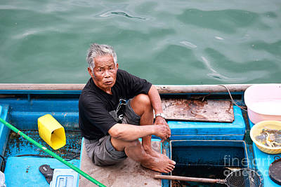 Photograph - Fisherman And His Catch by Charline Xia