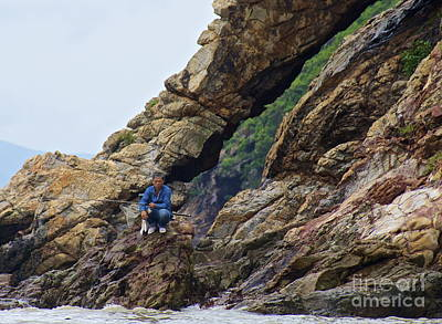 Fisherman On Rocks  Art Print