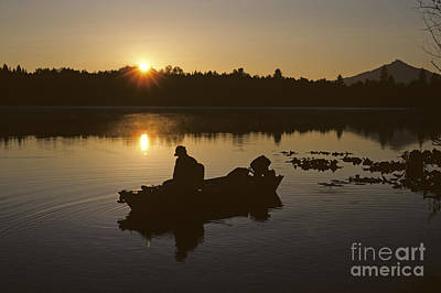 Photograph - Fisherman On Small Lake Silhouetted by Jim Corwin