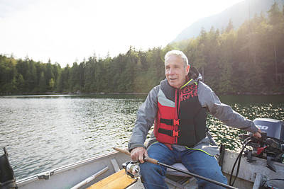 Harrison Hot Springs Wall Art - Photograph - Fisherman Sitting In Motorboat, Hicks by Christopher Kimmel