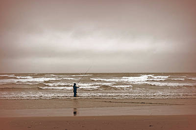 Photograph - Fisherman Weathering Incoming Storm by Tikvah's Hope