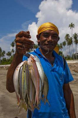 Fisherman With Catch In Indonesia Art Print by Science Photo Library