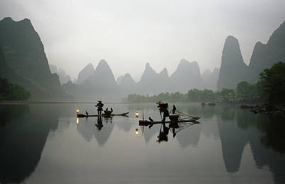 Fishermen In China With Cormorant Birds On Li River Print by King Wu