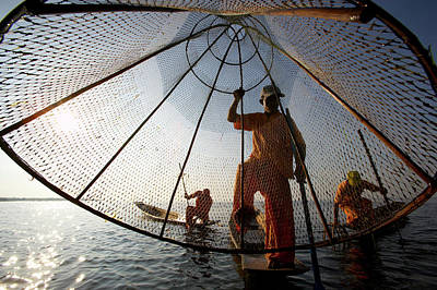 Oar Photograph - Fishermen In Traditional Orange by Johnny Haglund