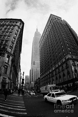 Fisheye Shot Of Yellow Cab And Empire State Building At Intersection Of 34th Street Broadway 6th Art Print by Joe Fox
