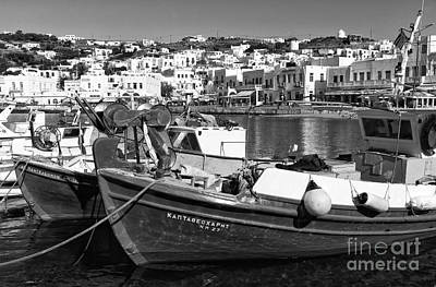 Photograph - Fishing Boats In The Mykonos Harbor Mono by John Rizzuto