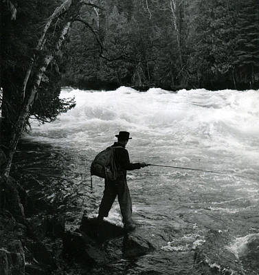 Backpack Photograph - Fishing In Fast Moving Stream by Retro Images Archive
