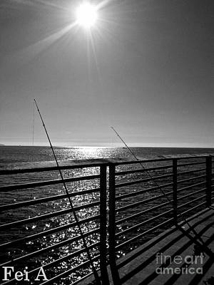 Photograph - Fishing Poles by Fei Alexander