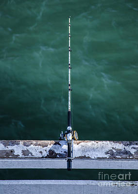 Photograph - Fishing Rod And Reel Over Emerald Waters At The Pier by Jerry Cowart