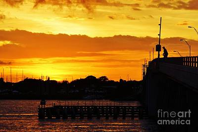 Photograph - Fishing The Bridge At Sunset by Lynda Dawson-Youngclaus