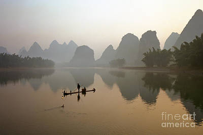 Fishing With Cormorant On Li River Print by King Wu