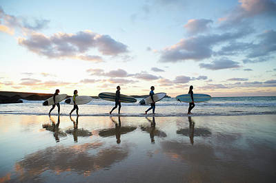 Holding Photograph - Five Surfers Walk Along Beach With Surf by Dougal Waters