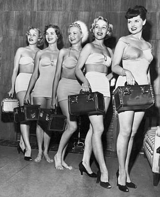 One Piece Swimsuit Photograph - Five Women Pose With Bags by Underwood Archives