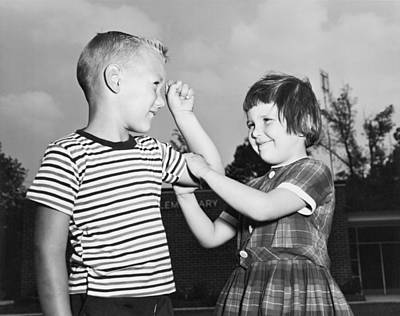 Adolescence Photograph - Five Year Olds Check Muscles by Underwood Archives