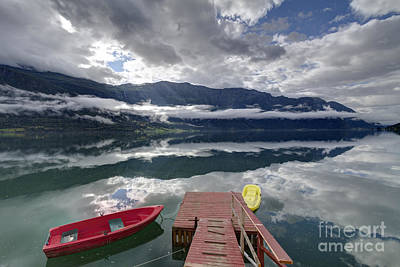 Double Layer Photograph - Fjord In Norway With Boat And Double Layer Of Clouds by Bart De Rijk