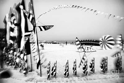 Photograph - Flags On The Beach by John Rizzuto