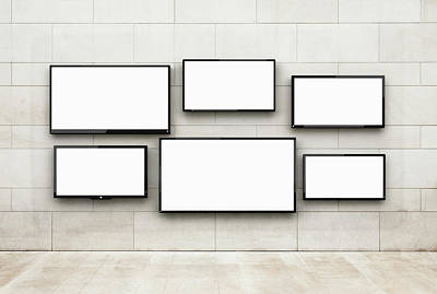 Flat Screens Hanging On A Wall Art Print by Jorg Greuel
