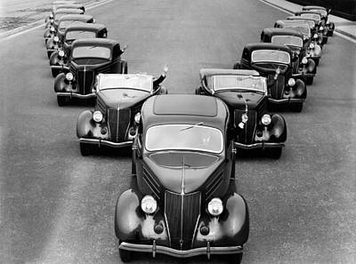 Photograph - Fleet Of Cadillacs by Underwood Archives