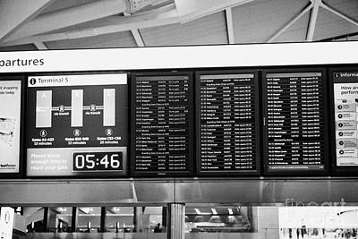 flight information boards London Heathrow Airport Terminal 5 early in the morning UK Art Print